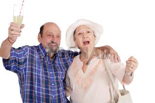 Eldery tourist couple proposing a toast