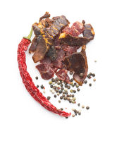 Beef jerky pieces. Dried beef meat.