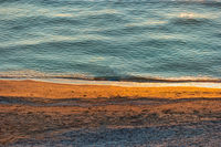 Seashore from above in sunset light