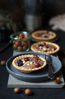 tartlet with chocolate cream, hazelnuts and chocolate
