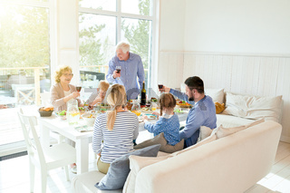 Happy Family Gathering at Dinner Table