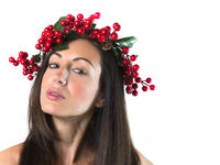 Cute woman with a Christmas wreath on her head