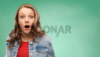 surprised student girl over green background