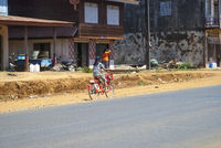 Girl riding a bicycle, Laos