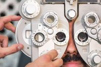 Eye ophthalmologist exam. Eyesight recovery. Astigmatism check concept. Ophthalmology diagnostic device.