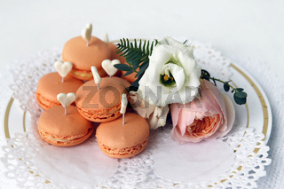 Cakes and boutonniere with roses