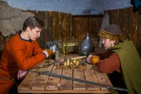 Two men playing popular strategy board game - tafl