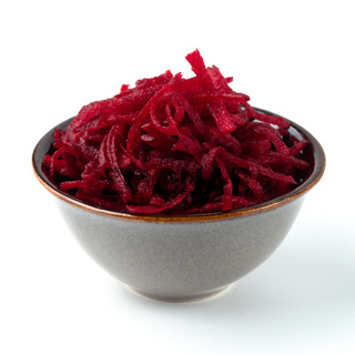 Grated beetroot in ceramic bowl isolated on white