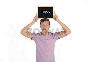 Man holding a chalkboard with 'courses' text