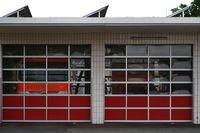 Fire truck behind garages