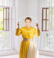 Middle Shot. Model in a Yellow Dress Posing with a Circle of LED Stripe