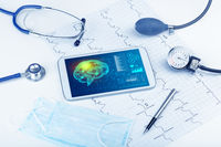 Diagnostics on tablet with brain functionality concept