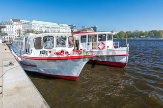 Alster ferries on the Binnenalster in Hamburg in summer