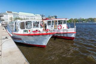 Alster ferries on the Binnenalster in Hamburg in summer