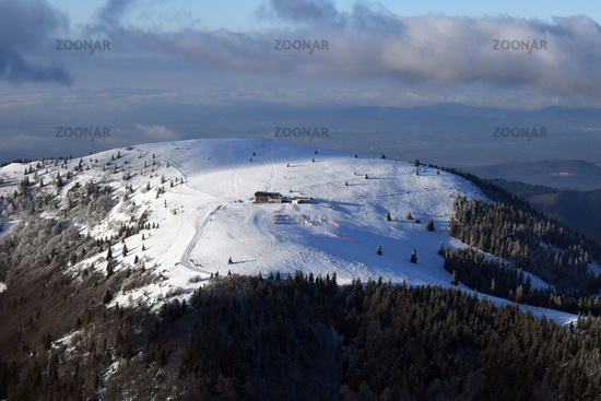 Snow-covered Belchen in the southern Black Forest with Belchenhaus