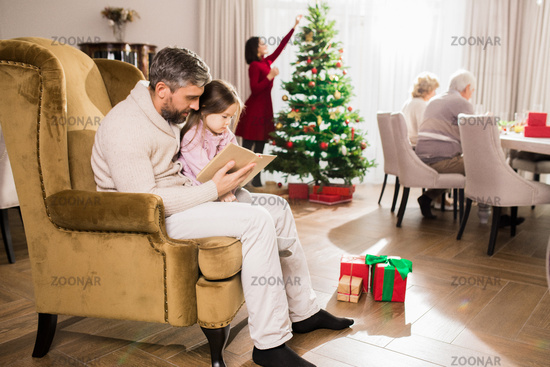 Mature Father Reading Book to Girl
