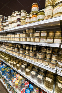 shelves lined with local products in the historic Gosselin store in Saint-Vaast-la-Hougue in Normandy