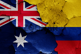 flags of Australia and Colombia painted on cracked wall