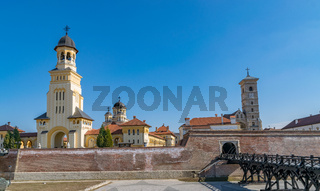 View to the Bell tower from Coronation Reunification Cathedral and to the Roman-Catholic Cathedral Saint Michael in Alba Iulia city, Romania