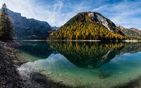Autumn peaceful alpine lake Braies or Pragser Wildsee. Fanes-Sennes-Prags national park, South Tyrol, Dolomites Alps, Italy, Europe.