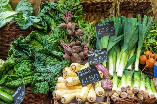 British parsnips, leek, savoy cabbage and other vegetables for sale at a market