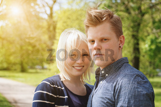 young couple enjoying sunny spring day in a park