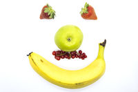 Smiling fruit face with currant mustach