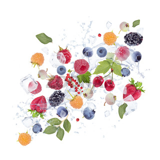 Fresh berries with water splash and ice cubes on white