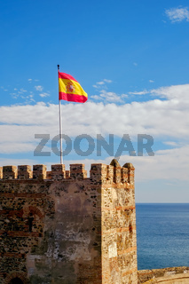 the spain flag on the fortress