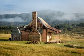 Old country homestead as the morning fog lifts