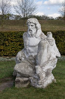 Neptune statue in the garden of the castle in Zolochiv Ukraine. Vertical position