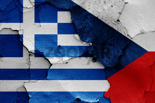 flags of Greece and Czech republic painted on cracked wall
