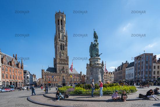 The Belfry of Bruges with market square in Bruges, Belgium.