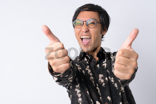 Portrait of happy Japanese businessman giving thumbs up