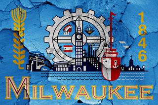 flag of Milwaukee painted on cracked wall