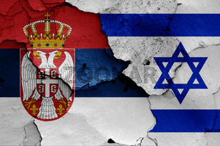 flags of Serbia and Israel painted on cracked wall