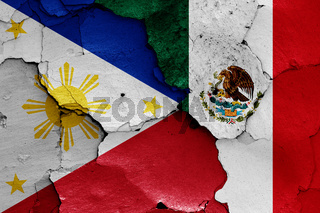 flags of Philippines and Mexico  painted on cracked wall