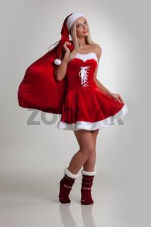 Girl in santa dress with gift bag