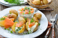 Baked potatoes with herb curd and salmon