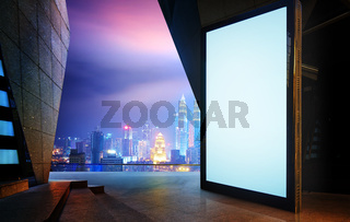 Big empty screen billboard with modern city background .