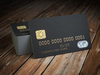 Stack of black blank credit cards mockup on  wooden table background.