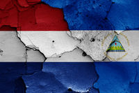 flags of Netherlands and Nicaragua painted on cracked wall