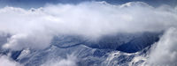 View on snowy mountains at mist