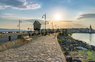 The wooden windmill on the isthmus at sunrise in Nessebar ancient city on the Bulgarian Black Sea Coast. Nesebar or Nesebr is a UNESCO World Heritage Site. The windmill in Nessebar, Bulgaria