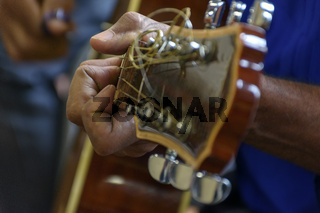 Hands and acoutisc guitar