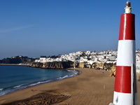 Cityscape in Albufeira in Portugal with a small lighthouse