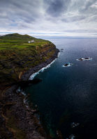 Vertorama / Panorama of a coastal region with lighthouse on Sao Miguel