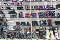 shoe shop with a lot of different shoes. Shoe store with many modern shoes. Shelves with various sho
