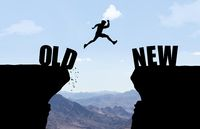 Man jumping over abyss with text OLD/NEW in front of mountain background.