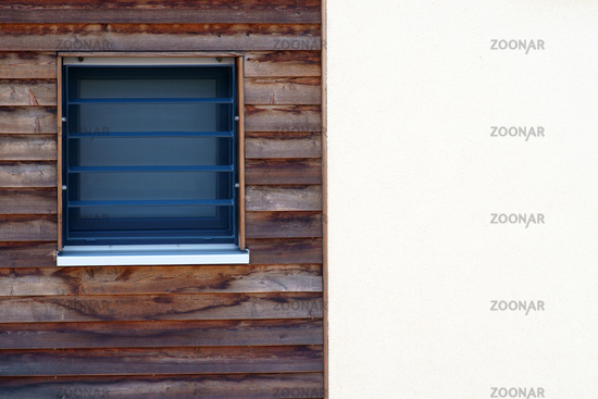 Square window in the wooden panel